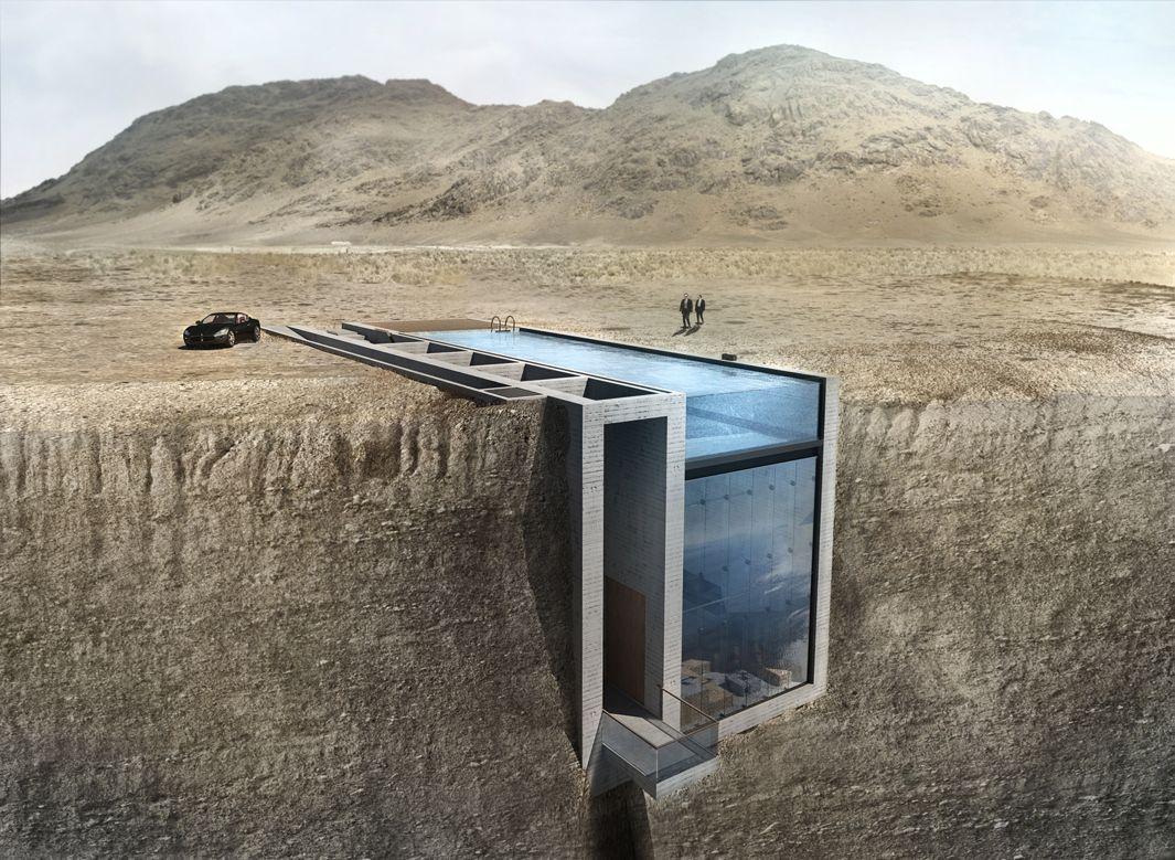 A concrete house inside a cliff